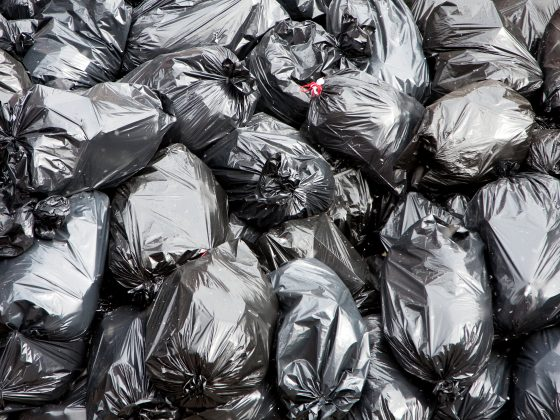 black garbage bags filled stacked 0